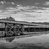 Rail trail bridge reflection BW