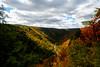Shaft of light striking side of mountain