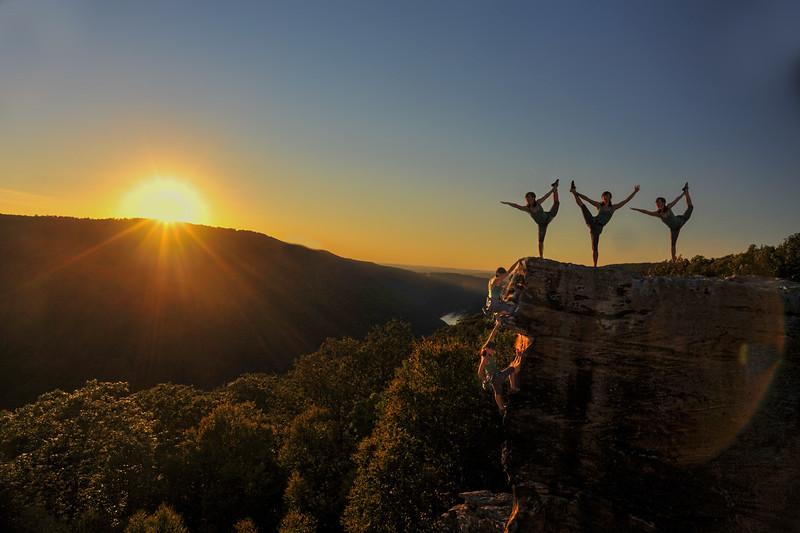 Rock Climber climbing and doing yoga