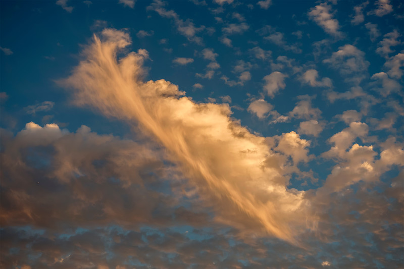 Fast moving February clouds turn golden as the sun sets in St. Augustine Florida