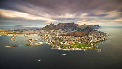 An aerial lanscape image of Cape Town city with Table Mountain. Photographed from a helicopter. South Africa.