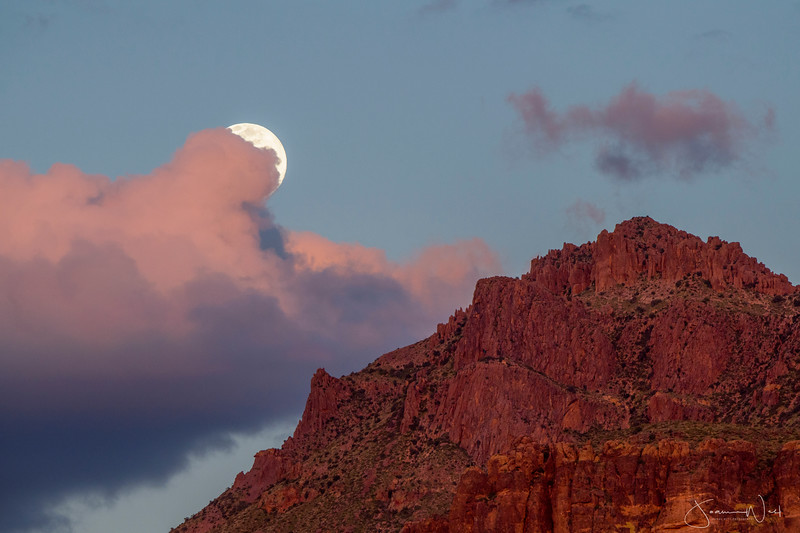 Pink Cloud Pushing out the Moon Over Superstition Mt.