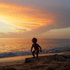"<b>""DANCING SHADOW BABY""</b>  St. Croix, US Virgin Islands  A child dances to the setting sun on Rainbow Beach on St. Croix's western shore."