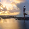 """MORNING YOGA""  The Big Island, Hawaii  A man doing his morning yoga routine is treated to an exhilarating natural display of light and waves."