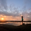 """SORCERER""  The Big Island, Hawaii  As a new day dawns, a woman raises her arms in exaltation."