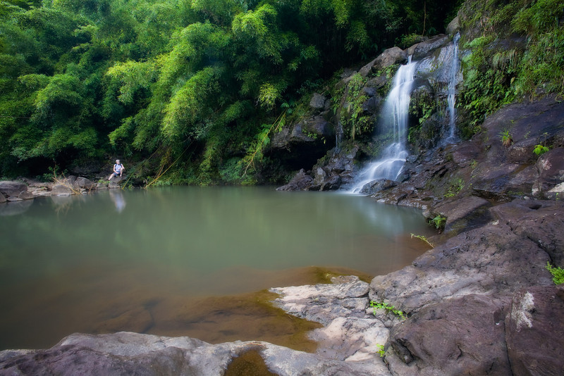 """<b>""""PEACEFUL""""</b>  Maui, Hawaii  A man enjoys peace and quiet at an unnamed waterfall near the Hana Highway on Maui's northern shore."""