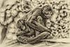 Monkey Cuddling Young