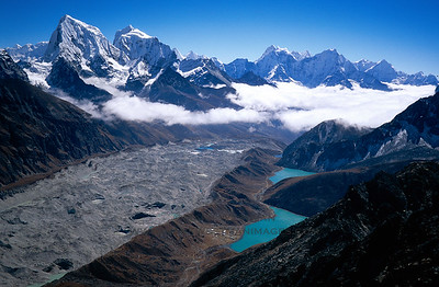 View south from the summit of Gokyo Ri (18,000'), high above Gokyo. Tawoche, Cholatse, and Thamserku stand above the valley.