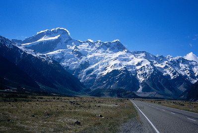 Mount Sefton looms above the road to Mount Cook Village, New Zealand.