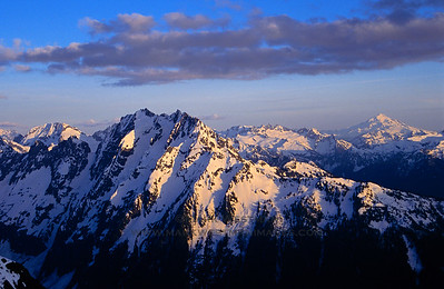 Evening light over Johannesburg Peak and Glacier Peak, North Cascades National Park, Washington.