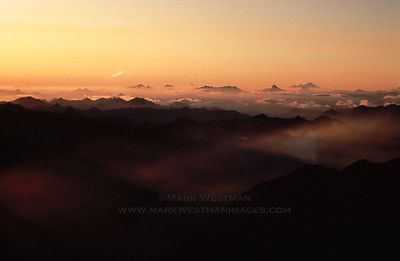 Sunset with wildfire smoke over the Cascade Mountains, Washington, from high on Mount Stuart.