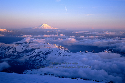 Sunset over the Tatoosh Range and Mount Adams from Mount Rainier, Washington.