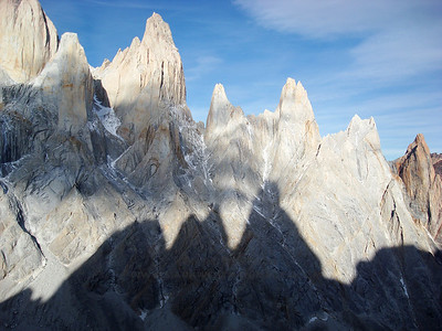 "West faces of Poincenot, Rafael, St. Exupery, De La ""S"", and Mojon Rojo, with the shadow of the Cerro Torre group."