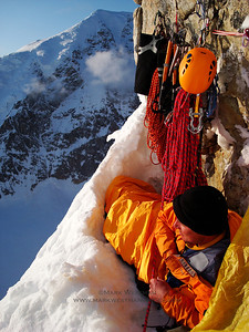 Eamonn Walsh settles into a tight bivouac on the Moonflower route on Mount Hunter's north buttress.  This photo was featured as the back cover of the 2008 Canadian Alpine Journal.