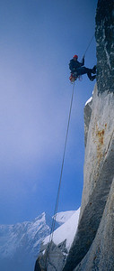 "Joe Puryear rappelling from the ""Nose"" pitch of Mount Huntington's Harvard Route."