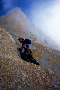 Colin Haley climbing in clouds and wind on the Argentine route, Aguja Mermoz.