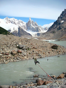 Tyrolean traverse over Laguna Torre outlet, enroute to Cerro Torre