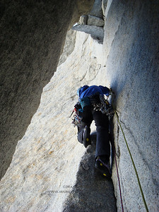 Mike Schmitt climbing near the summit of Torre de Media Luna.