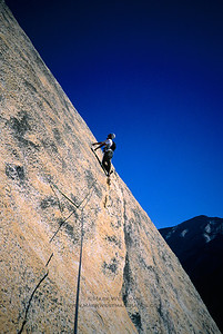 Slab climbing on Crest Jewel, North Dome, Yosemite National Park, California.