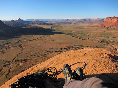 Relaxing on the summit of Sunflower Tower in Indian Creek, Utah, looking out towards the Six Shooters and Canyonlands National Park.