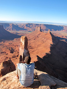 Stoney Richards enjoys the view of the Priest and Sister Superior from the summit of The Rectory, Castle Valley, Utah.