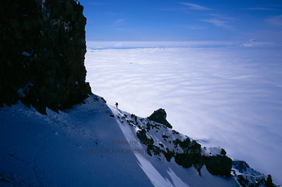 Above the cloud sea on Mount Rainier's Gibraltar Ledges route, Mount Rainier, Washington.