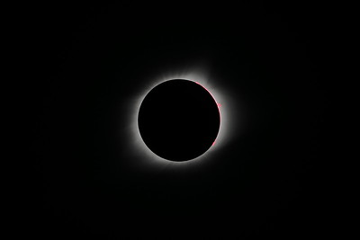 Totality: Corona, solar prominence (or filament), and a plasma loop.