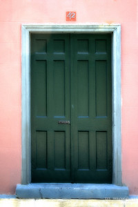 S155-1543c St Augustine Pink Wall Green Door