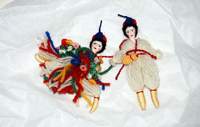 Hand sewn Greek Dolls on tissue paper.