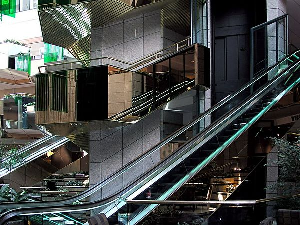 Mirrored escalators in the lobby of the Emerald Plaza Hotel.