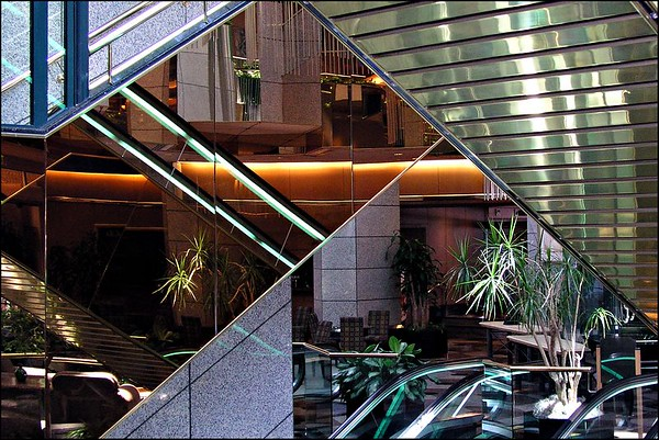 Mirrored escalators in the lobby of the Emerald Plaza Hotel, San Diego