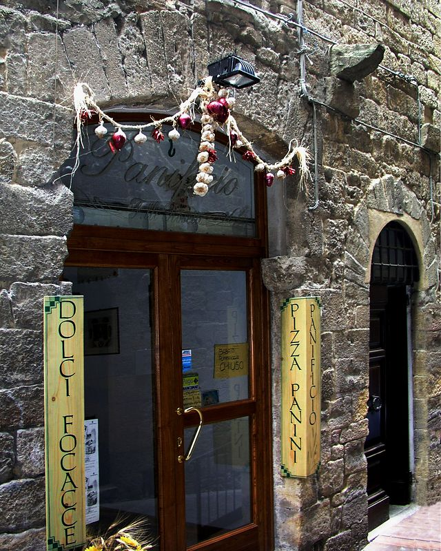 A cafe in the medieval town of Voltera. Notice the garlic over the door. I believe this is to ward off evil.