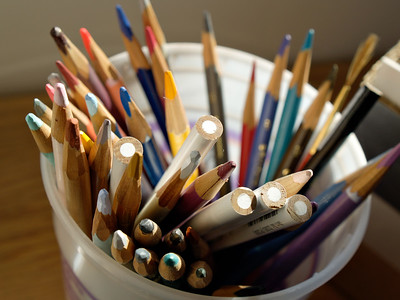 Colored pencils in glass