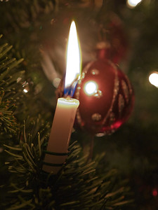 Candle and round ornament on Christmas Tree