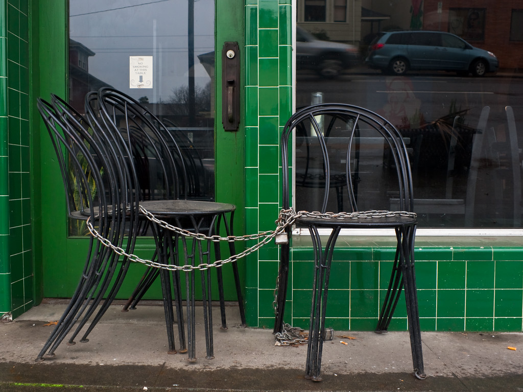 Chairs chain green tile wall Portland Oregon