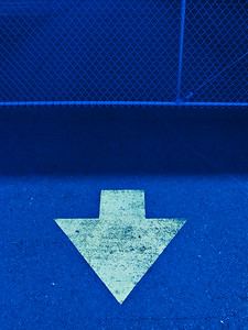 White arrow on blue pavement