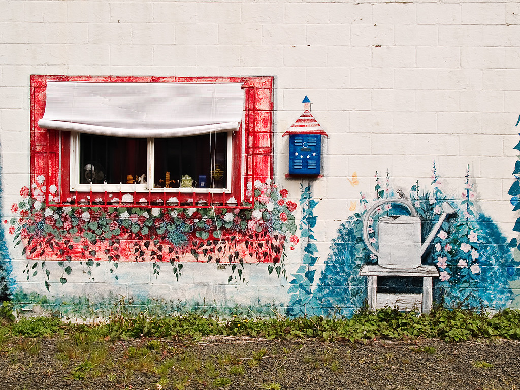 Wall art of flowers, watering can, mail box in Otis Oregon