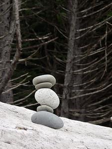 Stones on driftwood Washington Coast Pacific Northwest