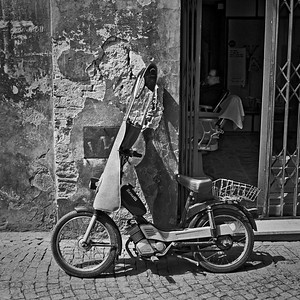 Moped parked outside a barber shop in Orvieto, Italy, 1985, Kodak TX.