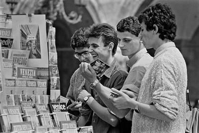 Tourists looking at travel brochures, Venice, Italy, 1985, Kodak TX.
