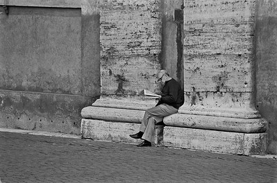 Man reading a newspaper, St. Peter's square, Vatican, 1995, Kodak TX.