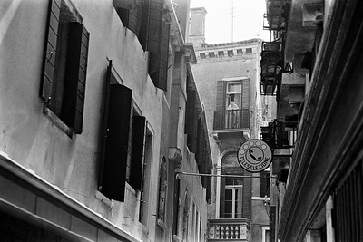 Woman in a doorway overlooking a canal in Venice, Italy, 1985, Kodak TX.