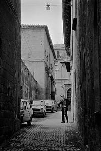 Man walking in an alley in Orvieto, Italy, 1985, Kodak TX