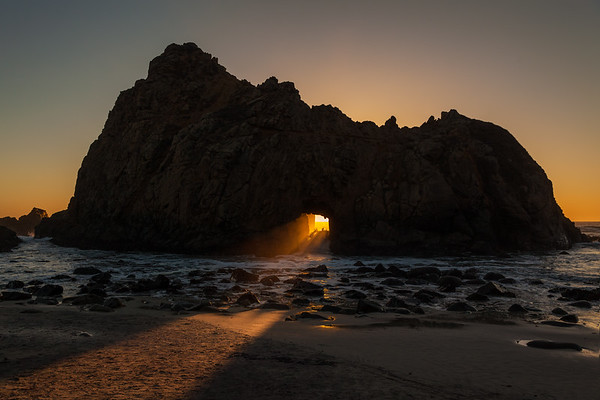 Big Sur sunset. The angle of the setting sun lights up this rock portal for about a two week period around the winter solstice.