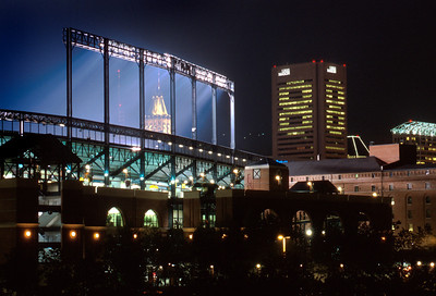 The offices of the Legg Mason buiding at 100 Light St. honors Cal Ripkin by lighting a number 8 on all four sides of the building. Here it is seen behind a bank of lights on the Baseball Stadium on 10/3/01. Maximilian Franz/The Daily Record
