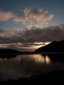 Father and son paddling a kayak on the Salmon River near Cascade Head, Oregon.