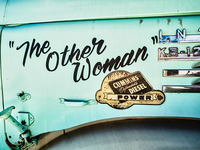 "Lettering (""The Other Woman"") on the side of an International truck - Cummins Diesel, Jerome, Arizona, 2010."