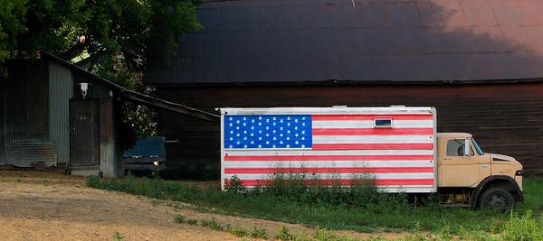 Ford truck with an American flag in a farm yard, Roslyn, Washington, 2007.