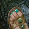 Foot with toenail polish and sandal, 2011.
