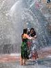 Two women in fountain summer